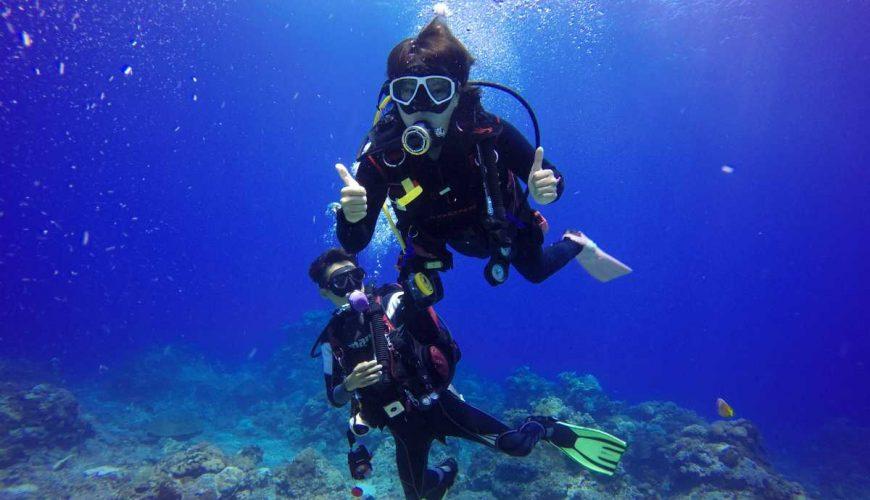 honeymoon couple underwater diving in andaman